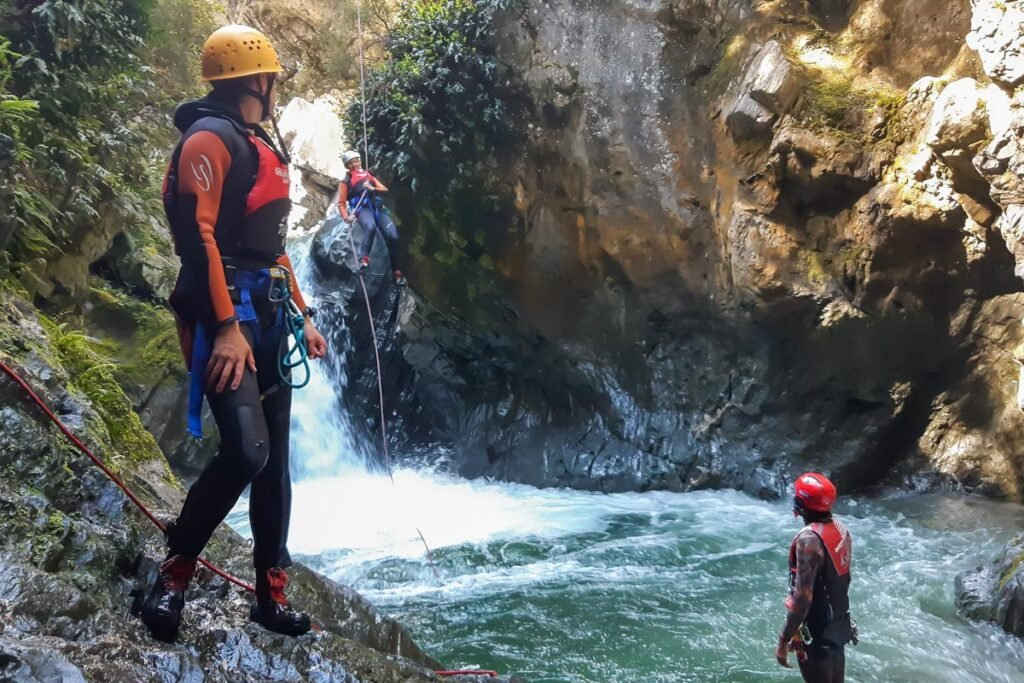 People on a canyoning tour in Queenstown, New Zealand