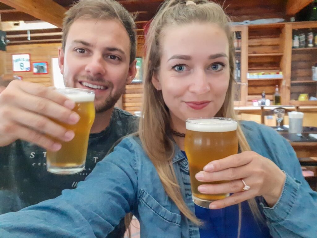 Bailey and her partner take a selfie with beers in Queenstown