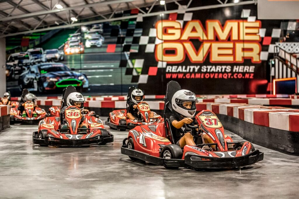 People ride go karts at Game Over Queenstown