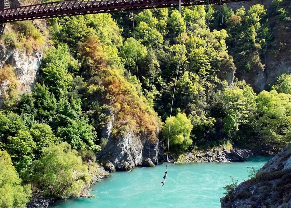 A person hangs from a bungy cord at Kawarau Bridge Bungy in Queenstown, NZ