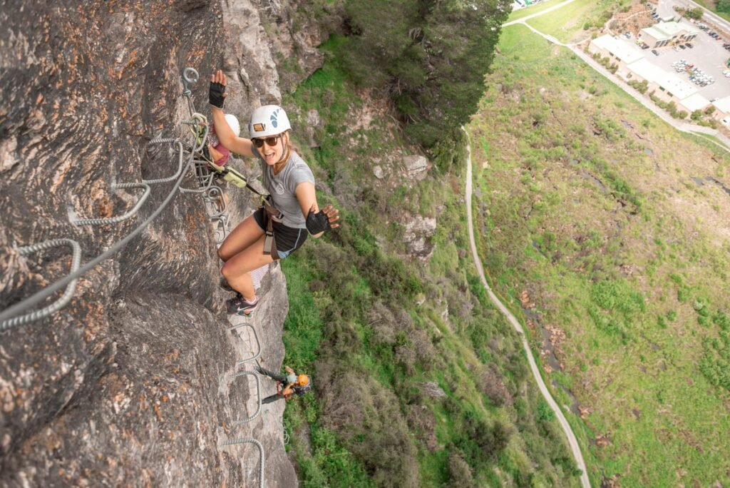 Tied up on the rock wall while doing the Via Ferrata Tour in Queenstown