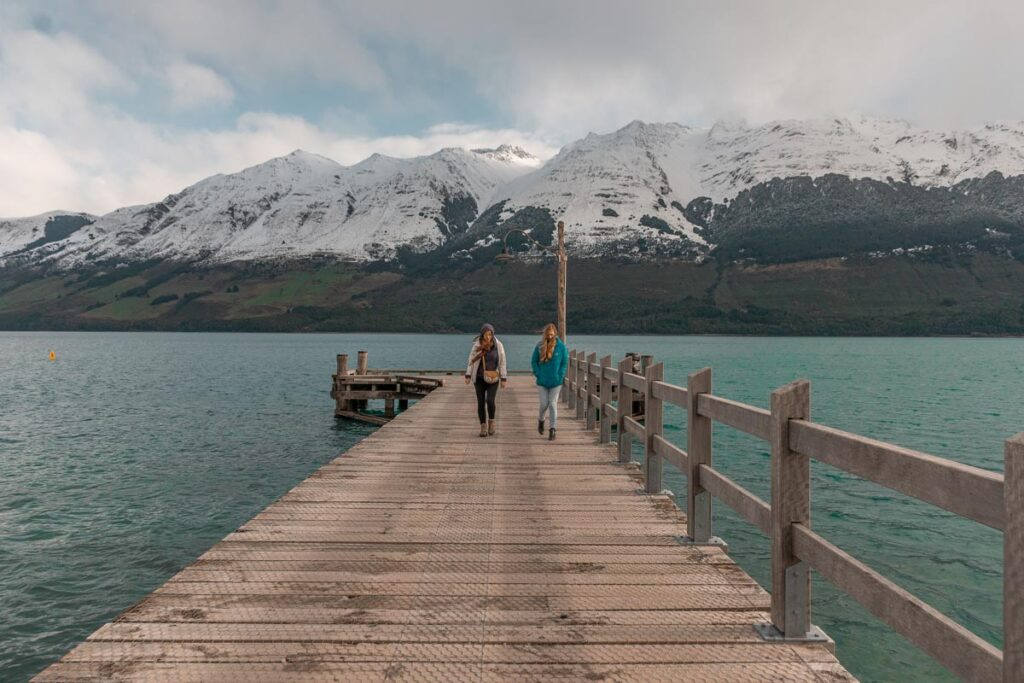 Two ladies walk the Glenorchy Jetty