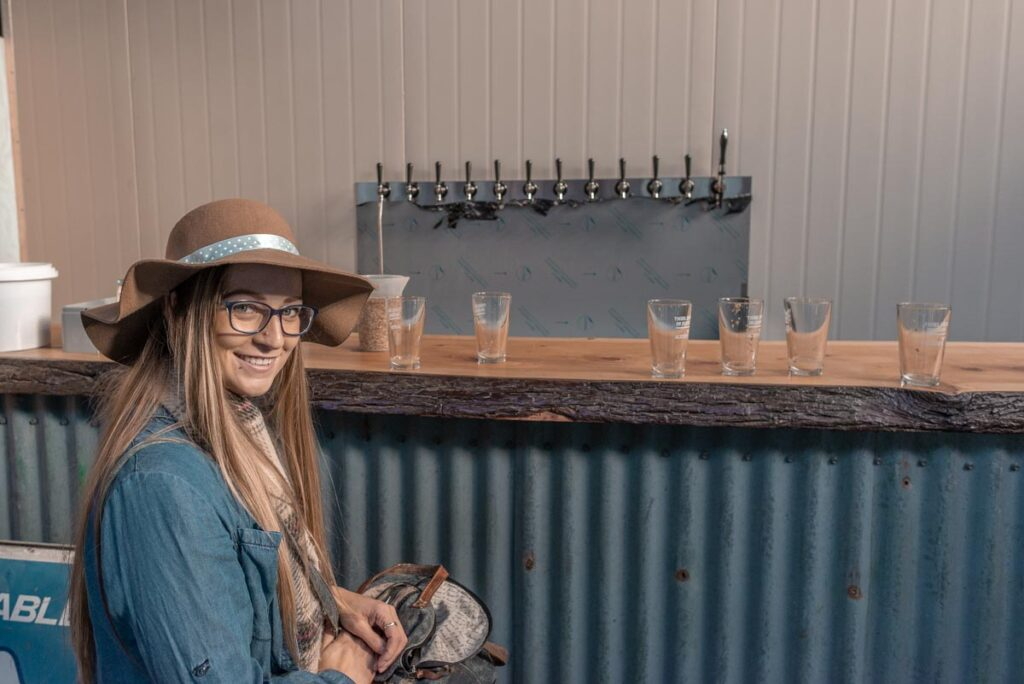 Bailey sits at the bar at Altitude Brewing in Queenstown