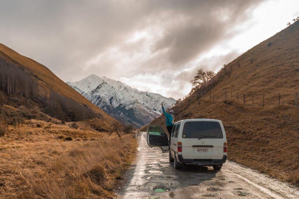 A van sits on the dirt road at Lake Dispute as it drives towards Moke Lake