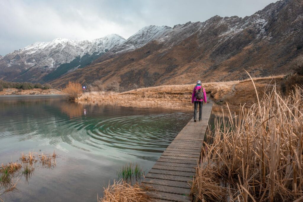 A lady walks along a bridge at Moke lake