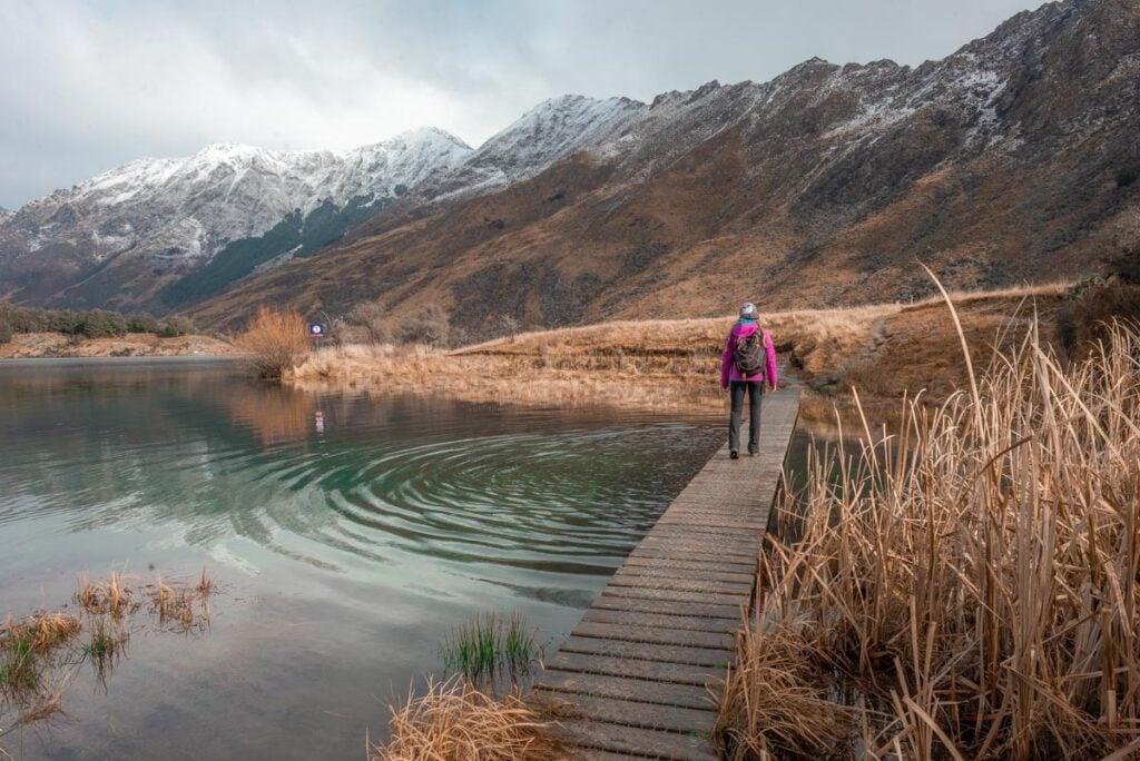 A lady walks along a bridge at Moke lake