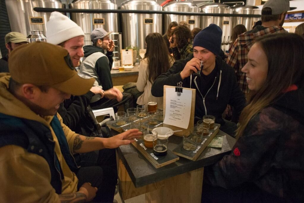 A group of people drinking beer at Searchlight Brewery, Queenstown