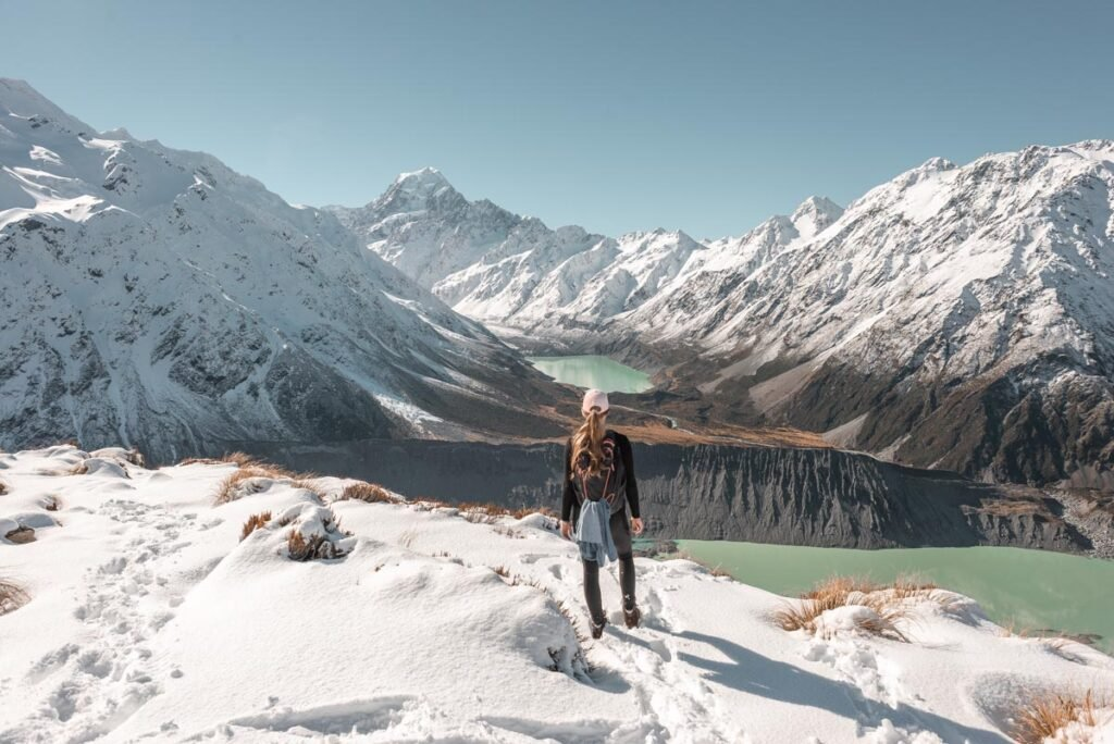 A lady stands at the viewpoint at the end of the Sealy Tarn Track in Mount Cook National Park