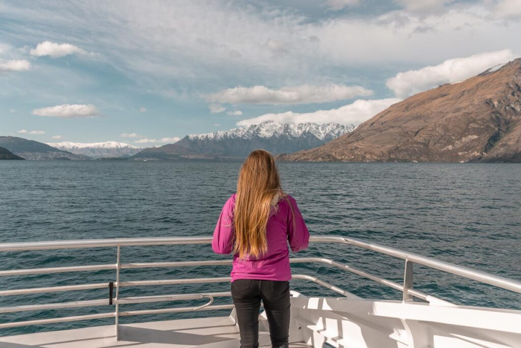 Standing at the front of the boat on a Lake Wakatipu cruise