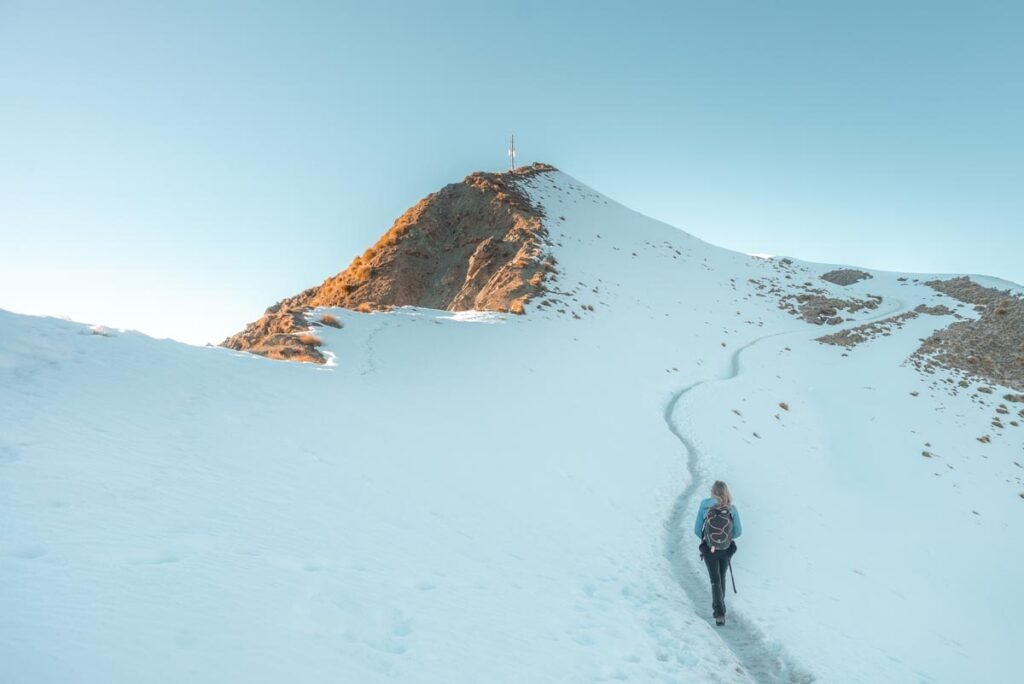 Hiking through the snow to the the real summit of Roy's Peak