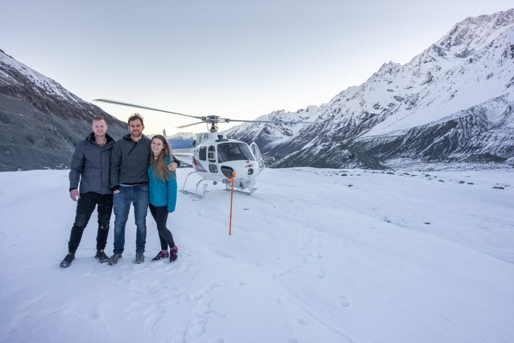 standing on a glacier after a helicopter ride in New Zealand