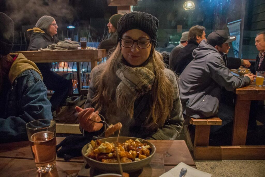 Bailey eats poutine and beer at Smithes Craft Beer house in Queenstown