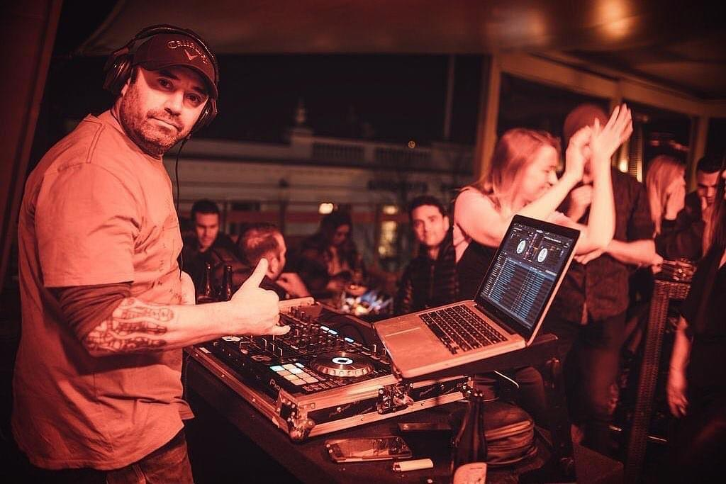 A DJ plays at the Sundeck in Queenstown, New Zealand