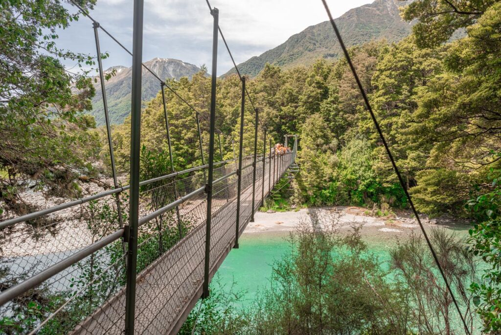 A suspension bridge over the Blue Pools on the west coast of New Zealand's South Island