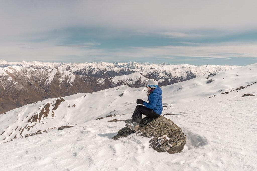 Sitting at the top of Cardrona Ski Resort looking out at the views