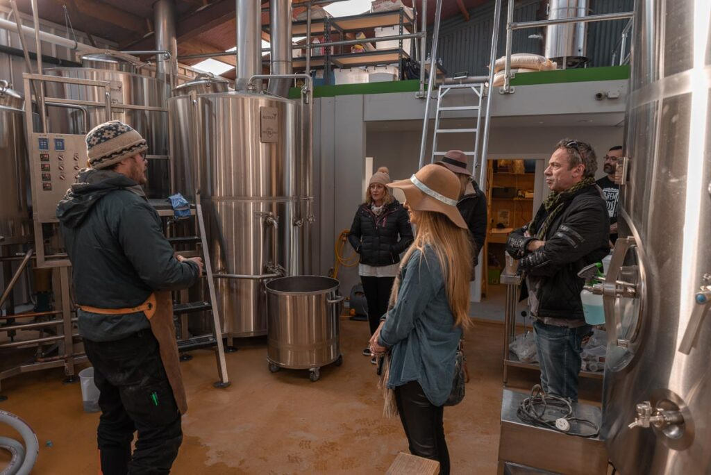 A group of people learn how to make beer at Altitude Brewing