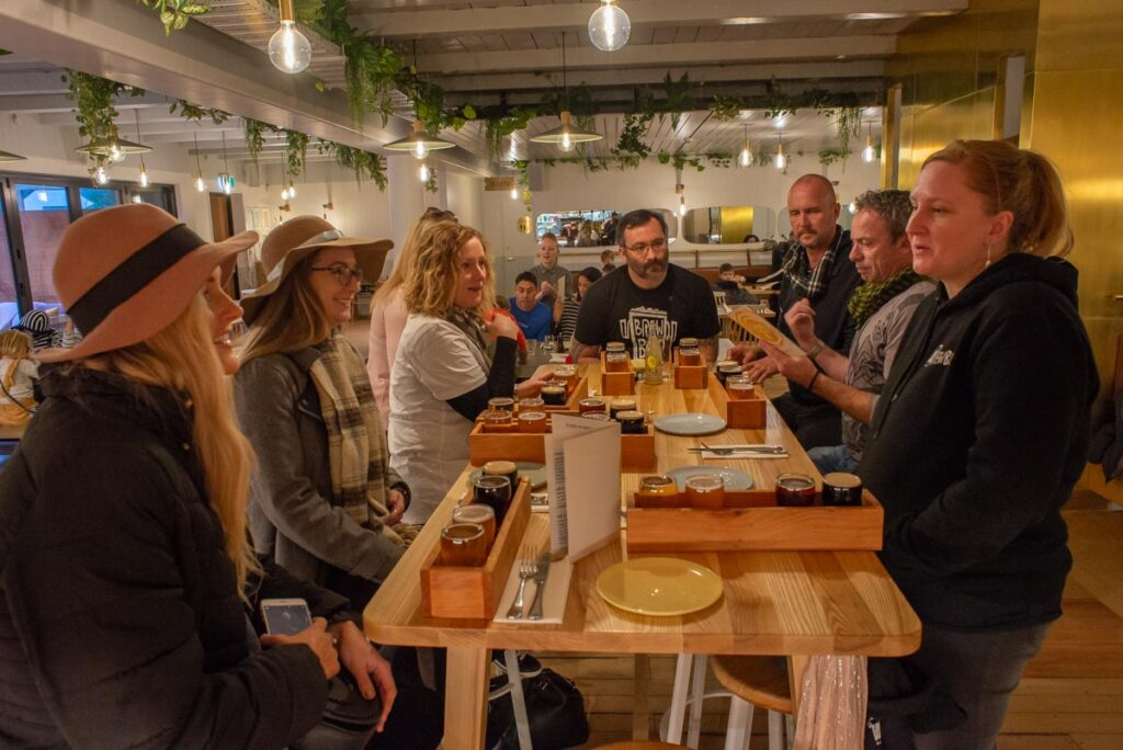 Enjoying craft beer and food at Canyon Brewing in Queenstown