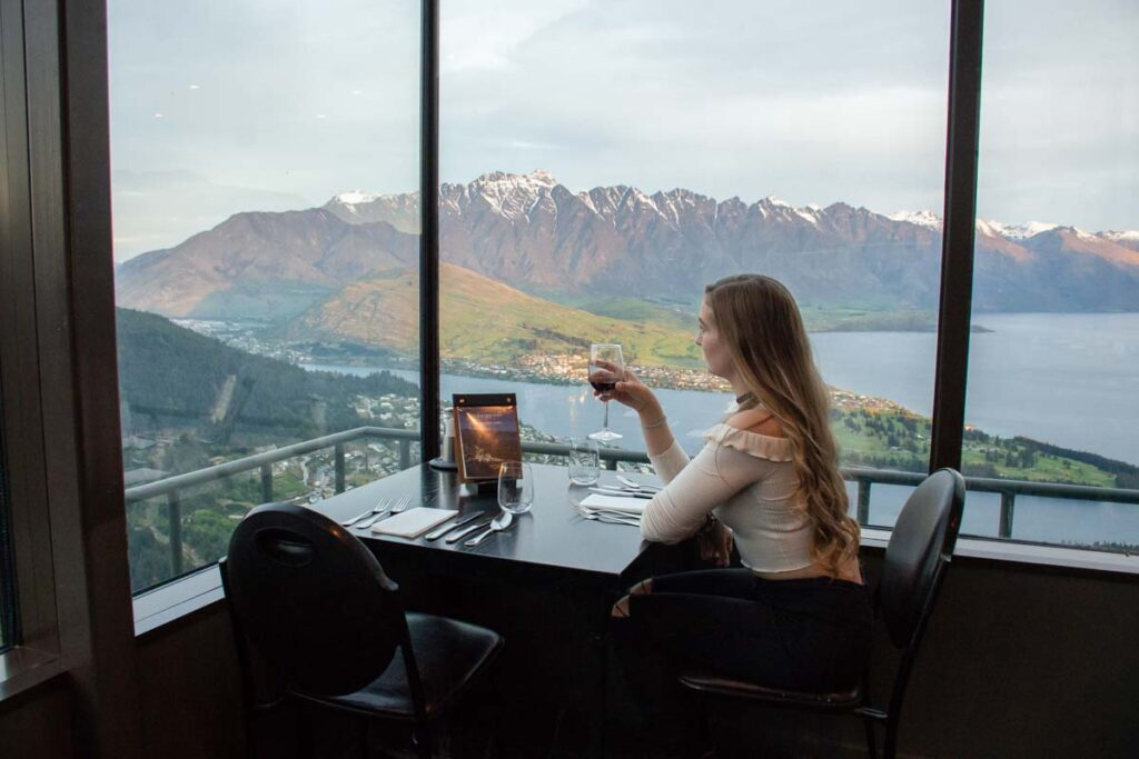 Enjoying a glass of wine at the Stratosfare Restaurant Queenstown with a beautiful view