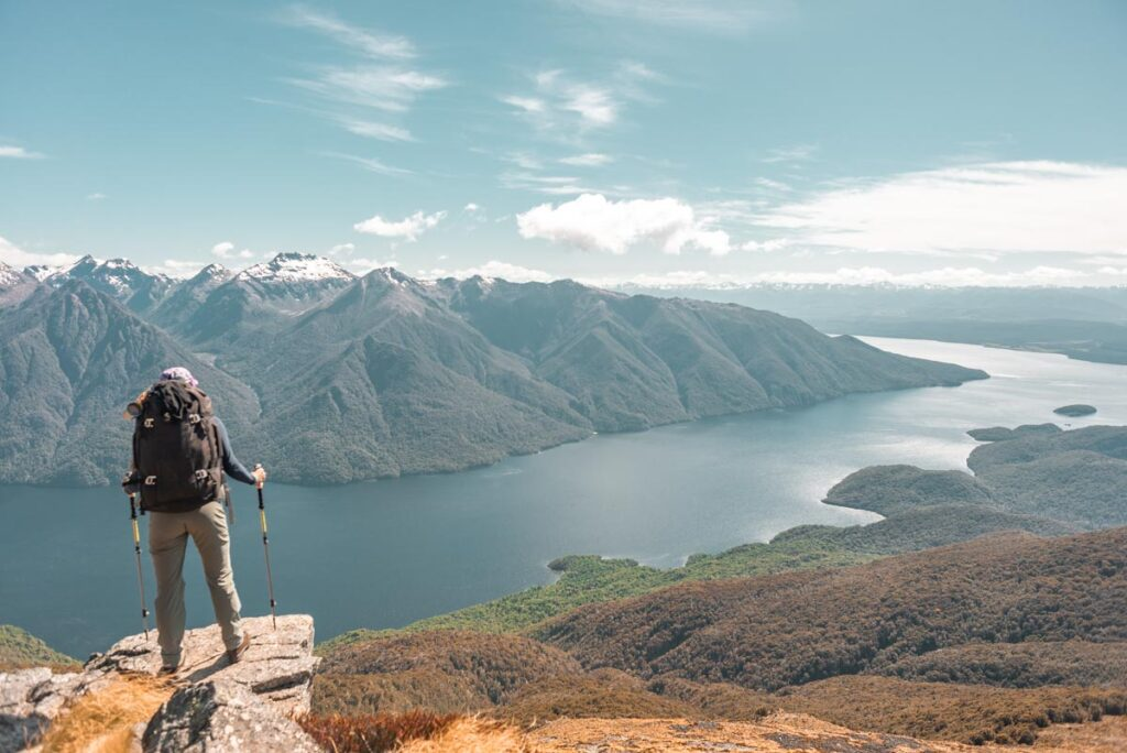 Bailey stands on a rock overlooking Lake Te Anau on the Kepler Track