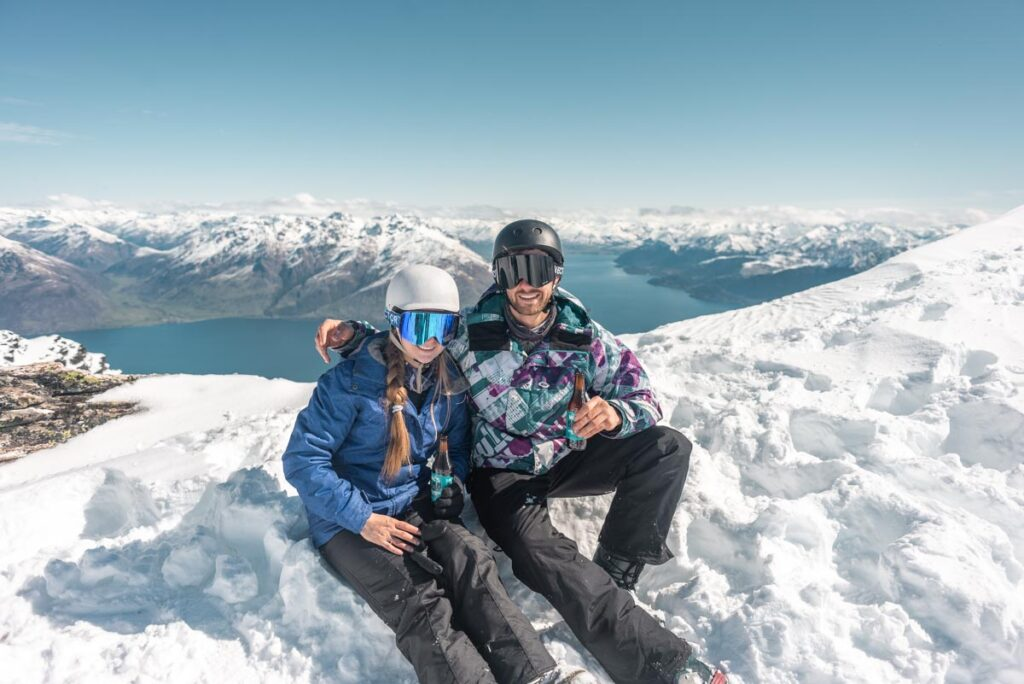 Bailey and her partner pose for a photo above the Remarkables Ski Field