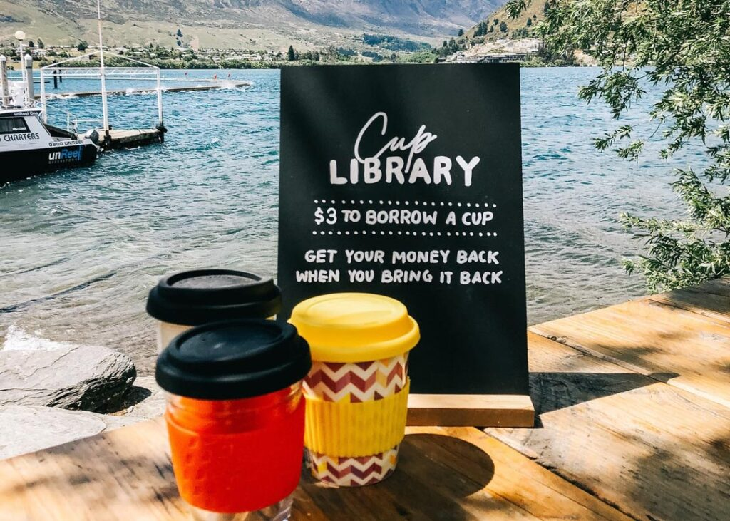 Two coffees by the water at The Boatshed in Queenstown
