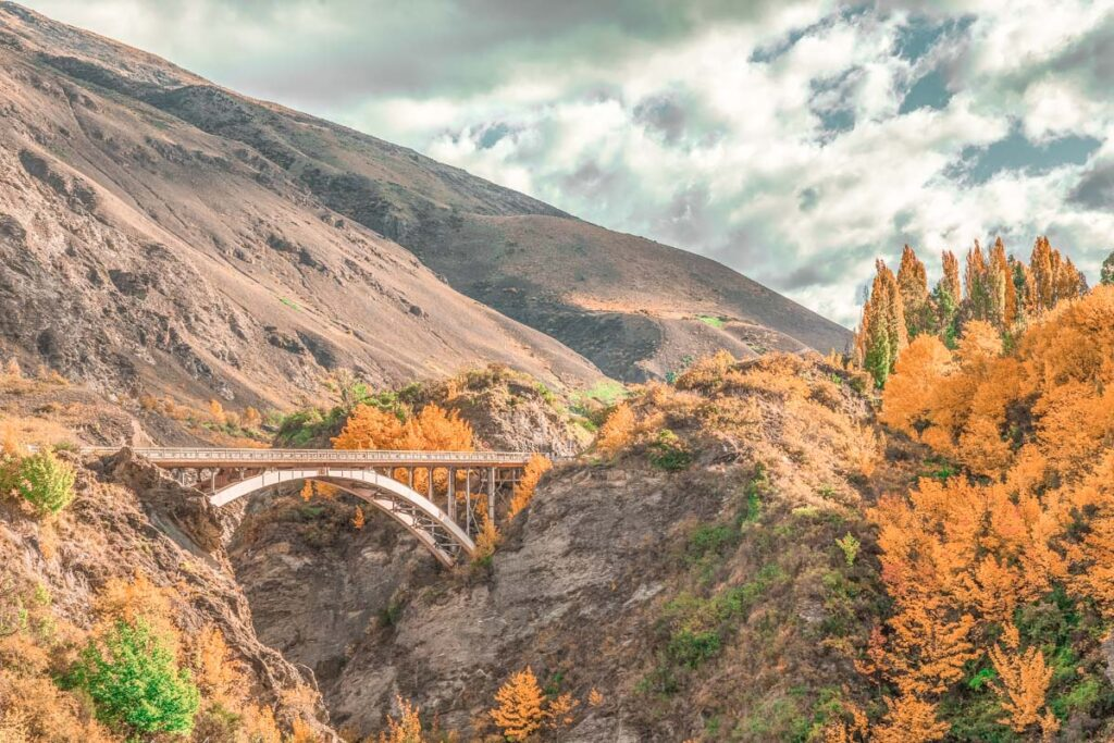 Old Old Lower Shotover bridge and Coronet Peak from bike trail in queenstown