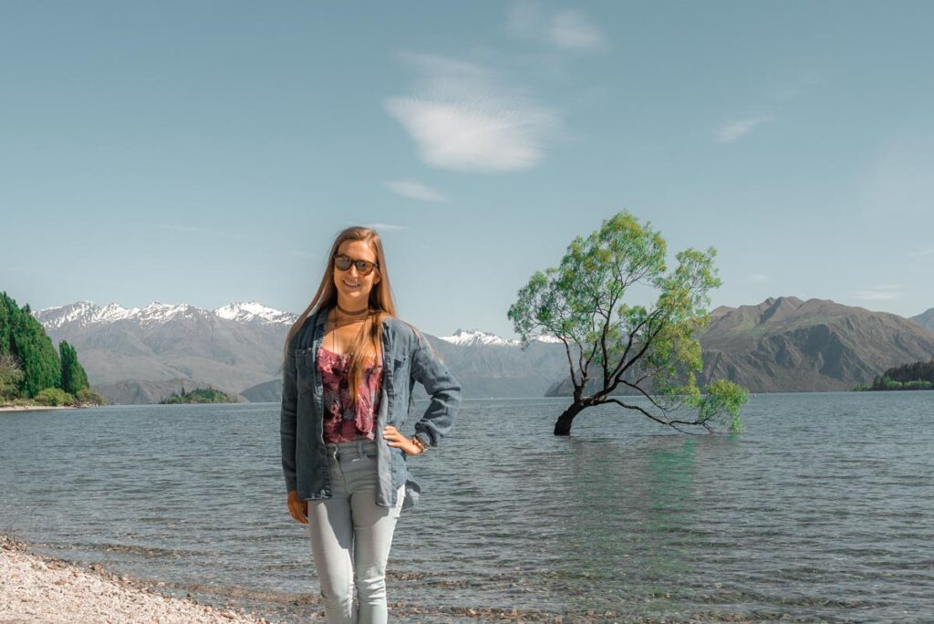 Bailey from My Queenstown Diary stands by the Wanaka Tree