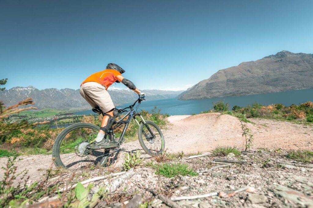 A man rides down the Queenstown Bike Park