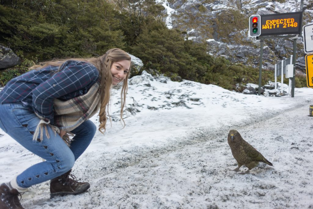 Bailey from My Queenstown Diary poses for a photo with a kea bird