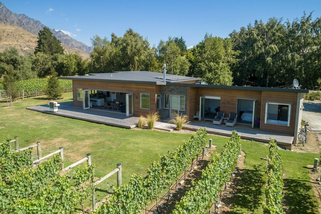 view of a beautiful airbnb near the shotiver river with a vineyard nearby in Queenstown, New Zealand