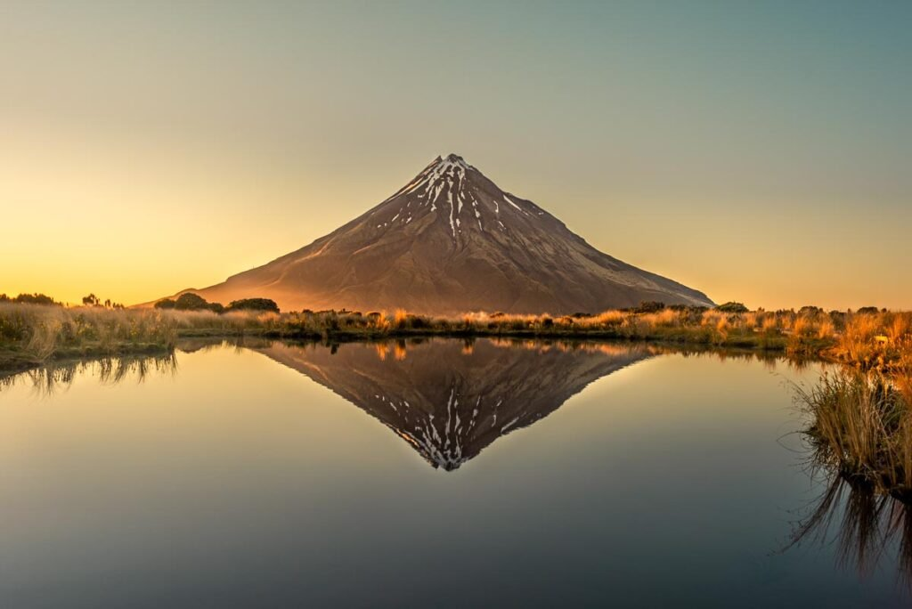 Reflection shot of Mt Taranaki at the Pouakai Tarn on the north island of New Zealand
