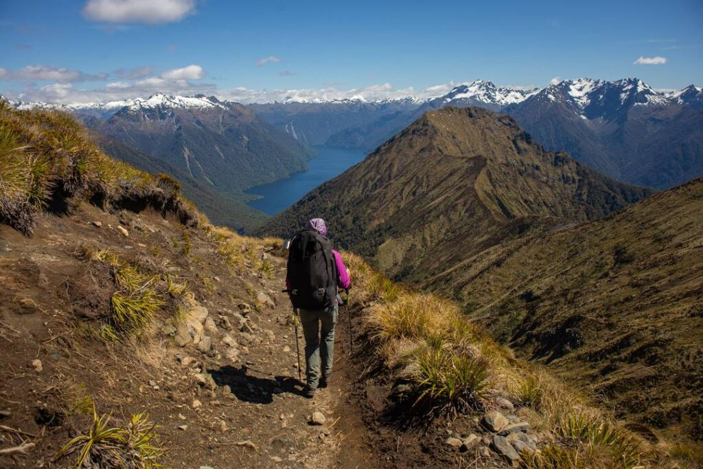 hiking with hiking poles on the Kepler Track in New Zealand