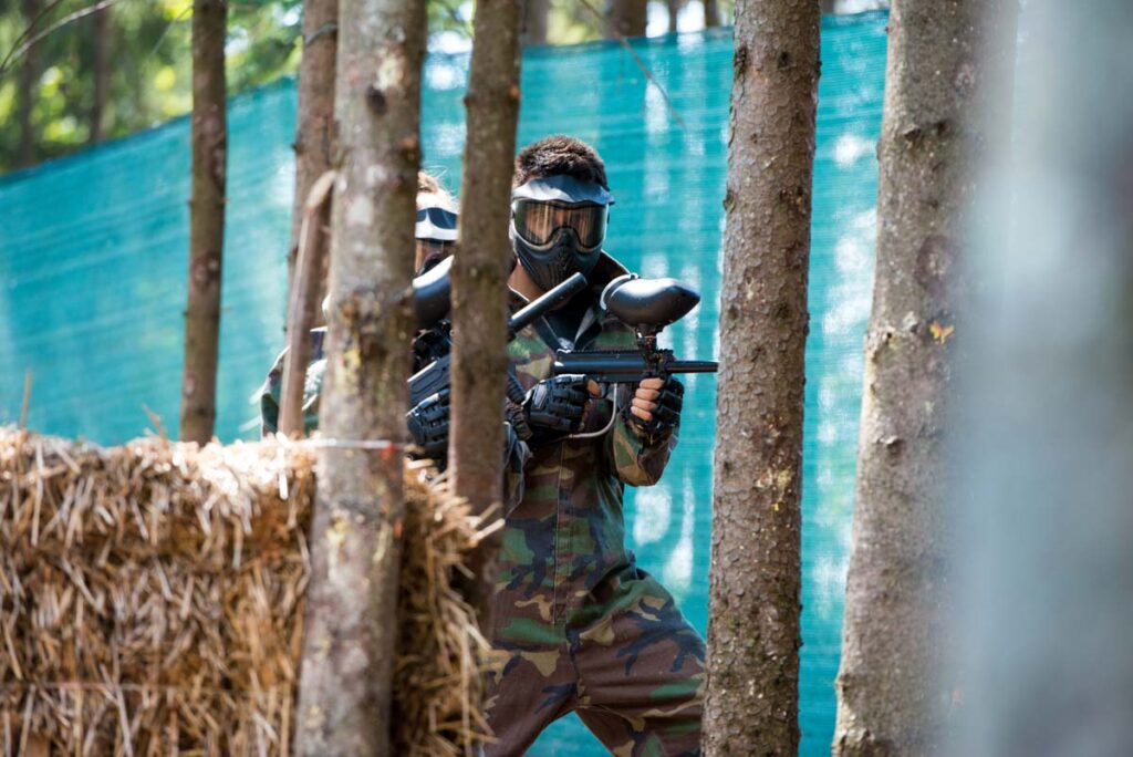 A person plays paintball at Paintball Central