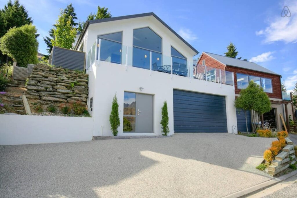 The outside of a large home available on Airbnb in Queenstown, New Zealand