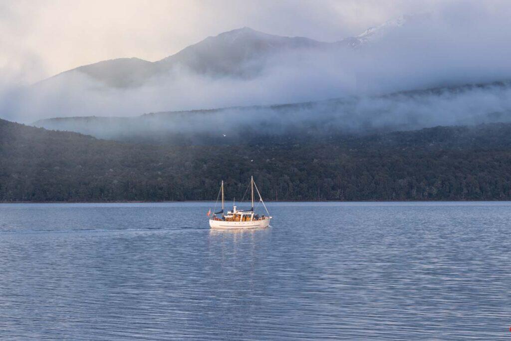A boat cruises Lake Te Anau