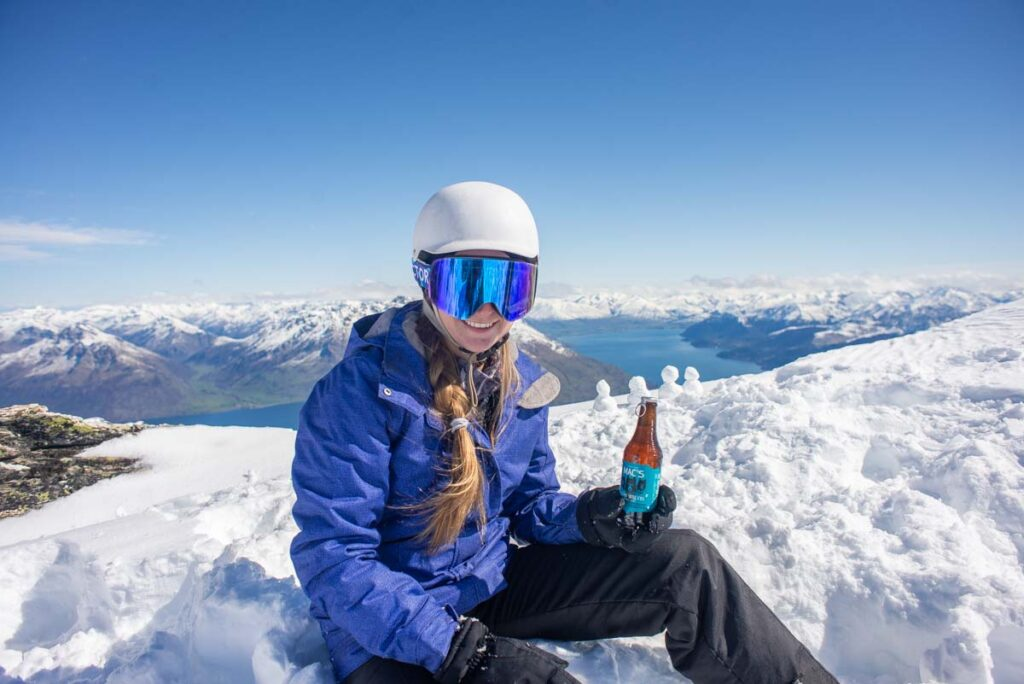 Bailey from My Queenstown Diary enjoys a beer at the top of the Remarkables Ski Area