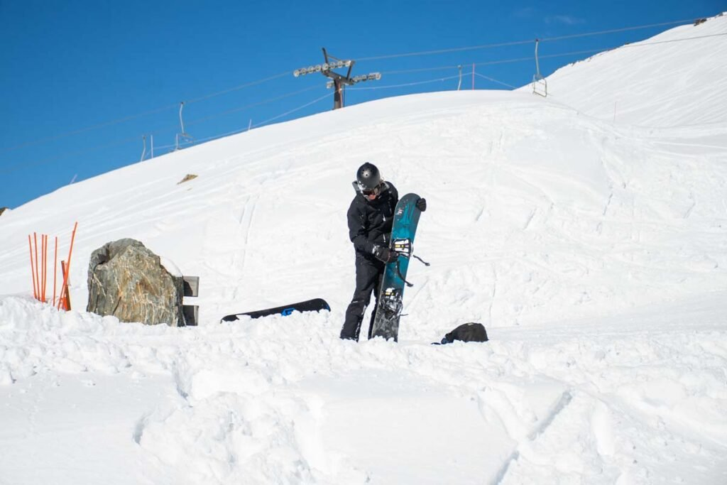 A snowboarder with rental gear at The Remarkables Ski Area