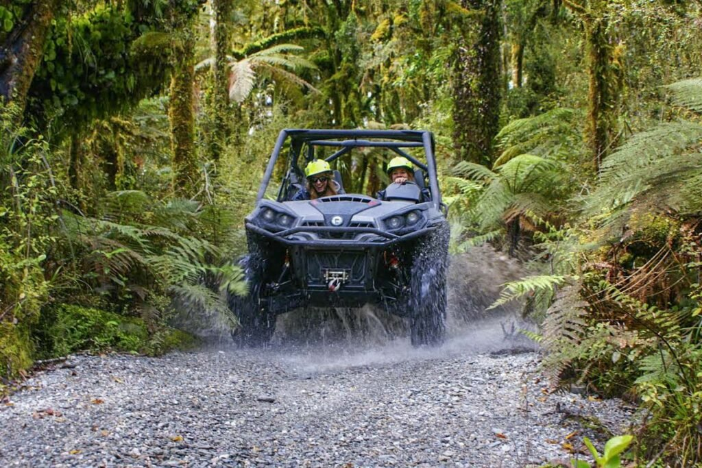A quad bike rases through the jungle near Franz Josef