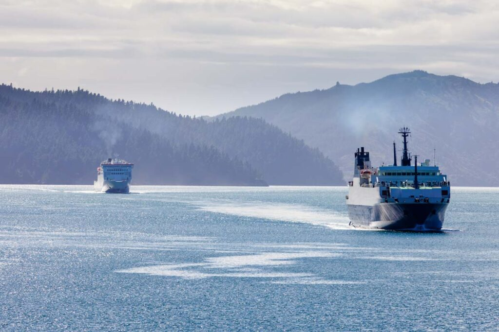 Two ferry's cross the Cook Strait into Queen Charlotte Sound from Wellington to Picton, New Zealand