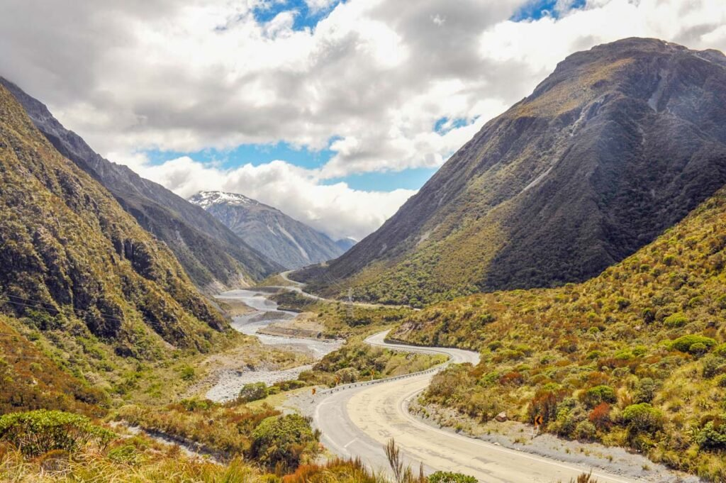 A road leads down a valley in Arthur's Pass, NZ
