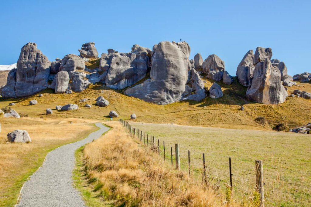 A path leads to the rocks at Kura Tawhiti / Castle Hill Conservation Area