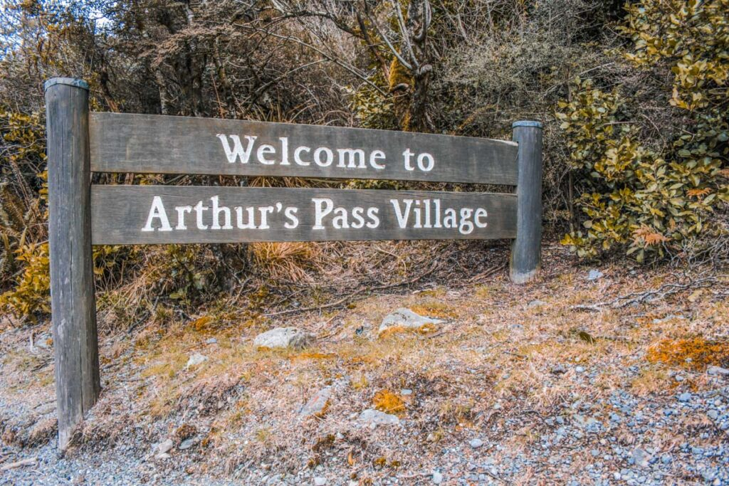 Sign welcoming people to Arthurs Pass Village