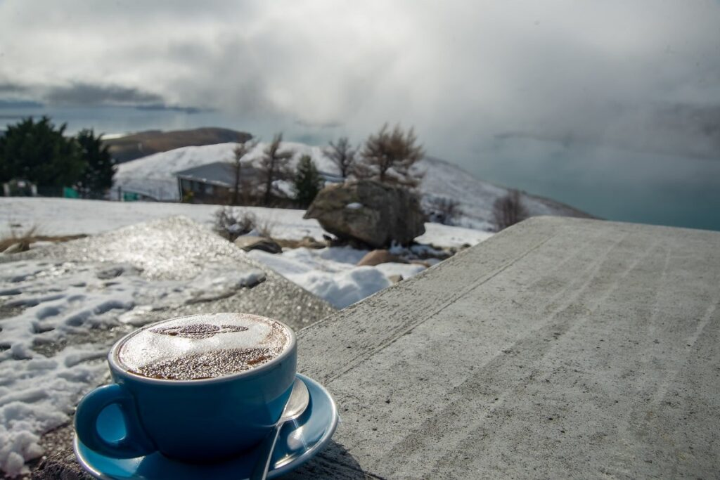 coffee with a beautiful view in winter at the Astro Cafe restaurant in Lake Tekapo